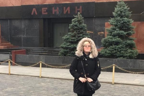 Alicia Baca standing in front of Lenin's mausoleum