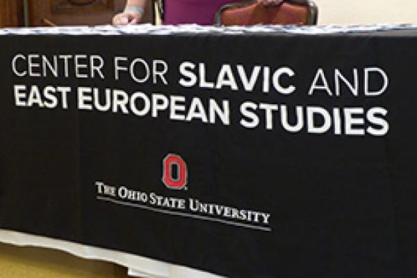 "A black tablecloth with white text ""Center for Slavic and East European Studies"""