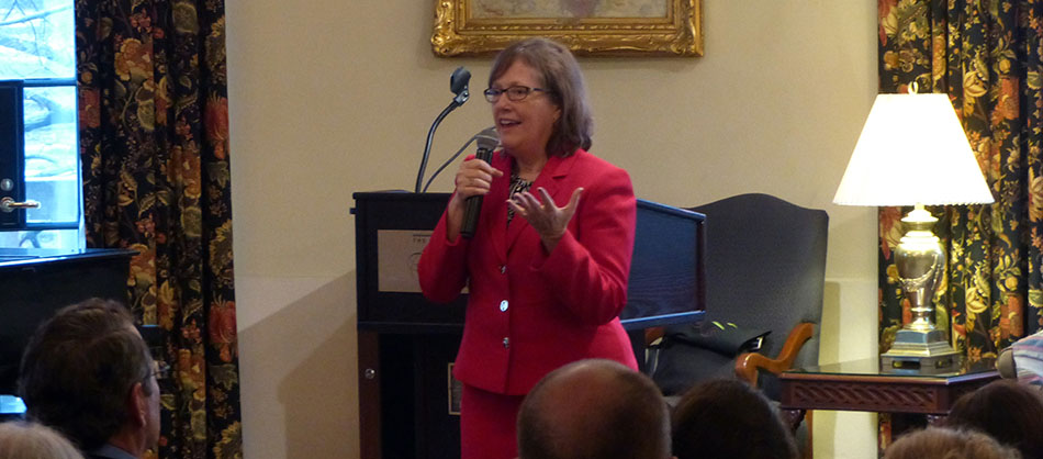 Dr. Karen Dawisha speaking to a group of people.